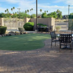 golfing green and outdoor patio seating